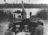 76.2 mm gun (captured during the campaign in the East) supports with fire the crossing of Tisa.