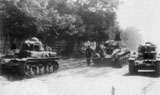 Two R-35 tanks tow a captured BT-2 in Bessarabia. July 1941.