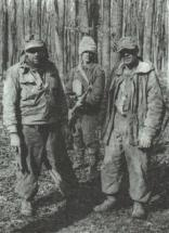 A soldier from the 21st Infantry Division escorting two German prisoners. The contrast between their equipment and the Romanian is obvious