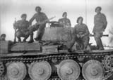 Mountain troops posing on a T-38 tank.